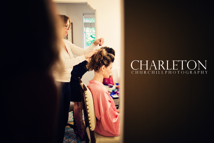 hotel room bride getting ready peaking in by photographer of wedding