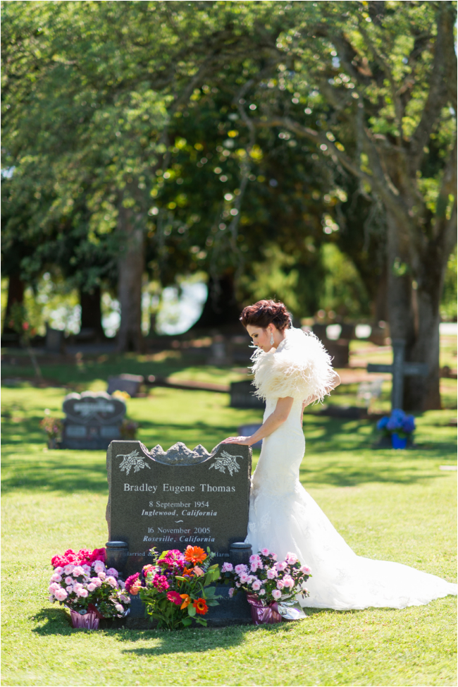bride at buriel graveyard site honoring father on her wedding day