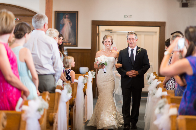 bride walked by father at jackson california wedding down aisle